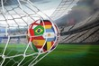 canvas print picture - Football in multi national colours at back of net