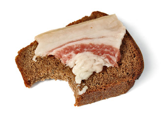 salted pork fat and Borodinsky rye bread isolated on white