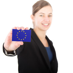 business woman holding a card with the flag the European Union