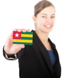 business woman holding a card with the flag of togo