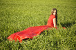 young lady in red dress on field