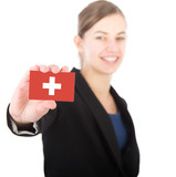 business woman holding a card with the flag of Switzerland