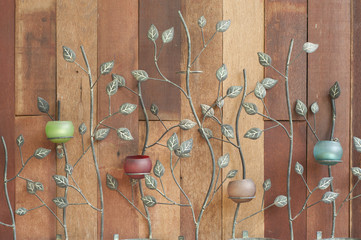 Candle lamp on wooden wall.