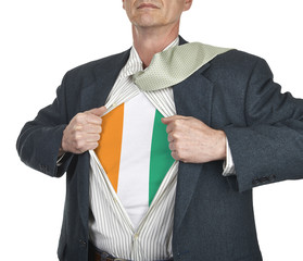 Businessman showing Ivory Coast flag superhero suit underneath h