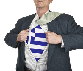Businessman showing Greece flag superhero suit underneath his sh