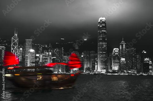 Fototapeta Hong Kong harbor at night with blurred silhouette of sailboat