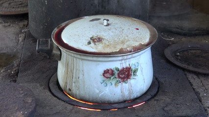 old pot boiling  in farm kitchen