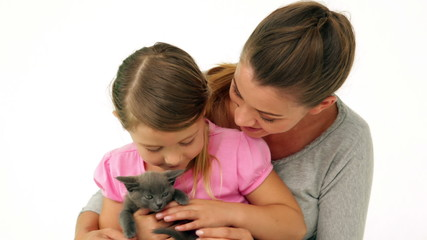 Cute mother and daughter with a little grey kitten