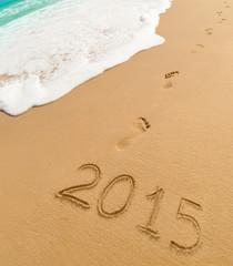 2015 and footprints on sand beach