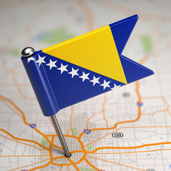 Bosnia and Herzegovina Small Flag on a Map Background.