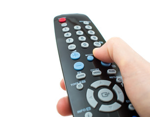 TV remote control in hand isolated closeup