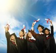 Happy multi ethnic group of graduated young students