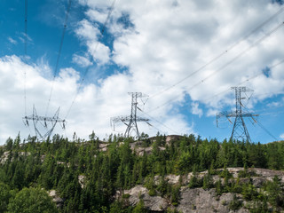 Low angle view of electricity pylons, Quebec, Canada