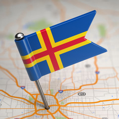 Aland Islands Small Flag on a Map Background.