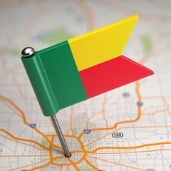 Benin Small Flag on a Map Background.