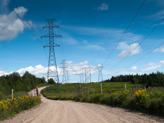 Electricity pylon passing through field, Quebec, Canada