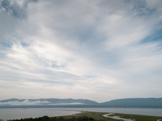 Clouds over river, Quebec, Canada