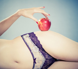 red apple at sexy female hips