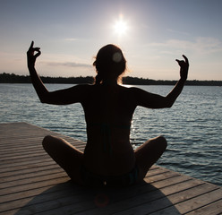 Silhouette of a woman practicing yoga at a pier, Georgian Bay, T