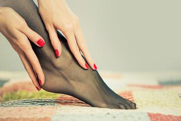 pretty woman leg in black pantyhose