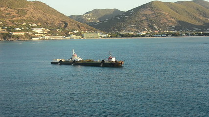 Industrial ship near caribbean island