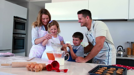 Smiling family making a cake together