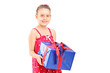 Young girl holding a wrapped present
