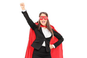 Woman in superhero costume with raised fist