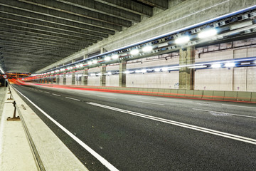 Abstract speed motion in urban highway road tunnel, blurred moti