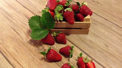 Fresh and ripe Strawberries on a wooden table