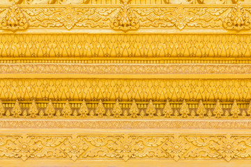 Thai traditional style stucco of golden temples walls