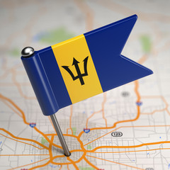 Barbados Small Flag on a Map Background.