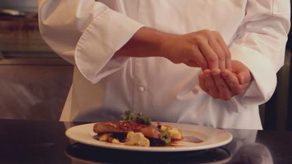 Chef seasoning dish