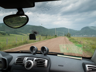 Road to village seen through windshield of a car, Quebec, Canada