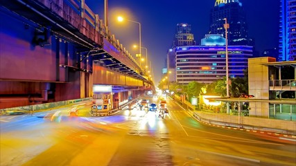 Traffic in city at night with car speed.