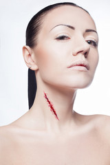 beautiful girl with a cut on neck