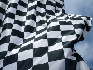 Low angle view of a chequered flag