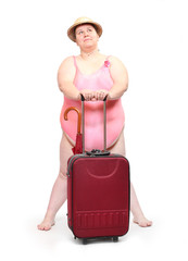 Funny overweight woman in swimsuit going to vacations.