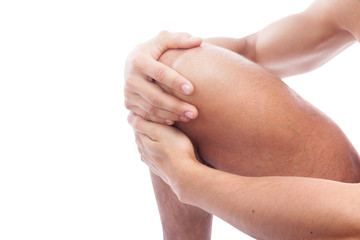 Muscular man having knee pain, isolated on white background