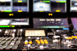 Wide shot of vision mixing panel in a television gallery.