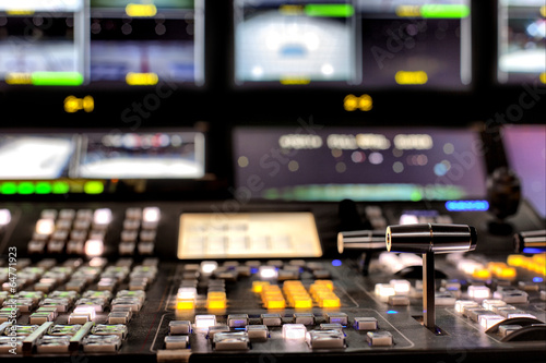 Wide shot of vision mixing panel in a television gallery. - 64771923