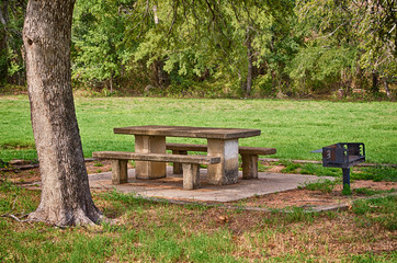 Picnic area with table and grill in the park