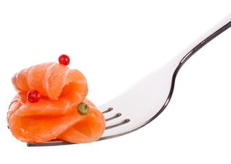 Salmon piece on fork isolated on white background cutout