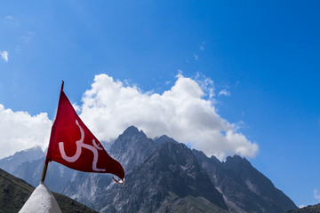 Red Om Flag in the Indian Himalayas