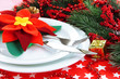 Christmas table setting with festive decorations close up