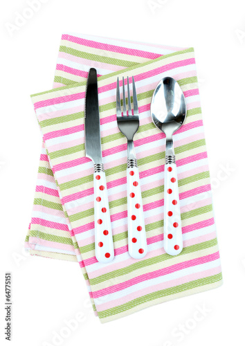 Kitchen cutlery on color napkin isolated on white