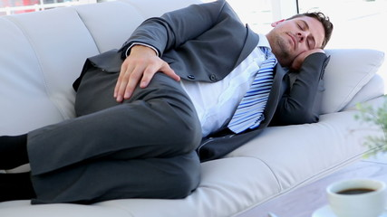 Businessman sleeping on the sofa