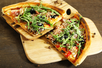 Piece of pizza with arugula