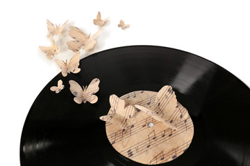 Old vinyl records with paper butterflies, isolated on white