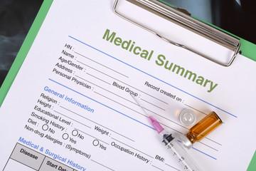 Medical summary on clipboard.
